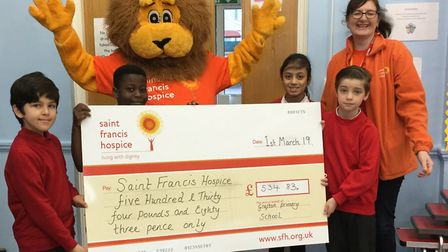 Grafton Primary School pupils present the cheque to Saint Francis Hospice fundraiser Michelle Hughes