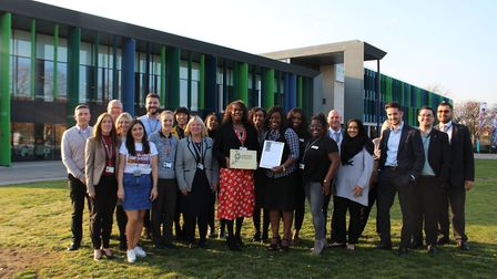 Barking and Dagenham College staff celebrate the college getting the Investors in People Gold Standa