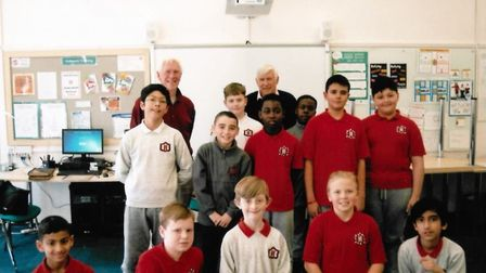 Old players David Wade and Graham Hellberg meet the current football team at Hunters Hall Primary. P