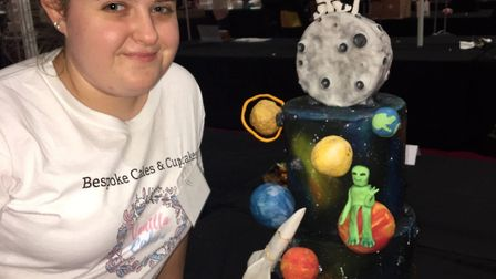 Amy Penfold with her space-themed cake. Picture: BARKING AND DAGENHAM COLLEGE