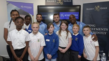 Godwin and John Perry primary school pupils with West Ham players Jack Wilshere, Ryan Fredericks and