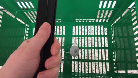 Security tags have been added to the shopping baskets in Asda's Barking branch. Picture: Sophie Mort