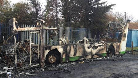 The wreckage of a bus-come learning space and library at Rush Green Primary School after an arson at