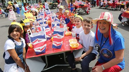 Headteacher Thelma McGorrighan with pupils from Manor Infants during a past celebration marking the