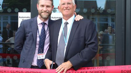L-R: Robert Clack headteacher, Russell Taylor, with former deputy, Mick Fox MBE, as he cuts the ribb