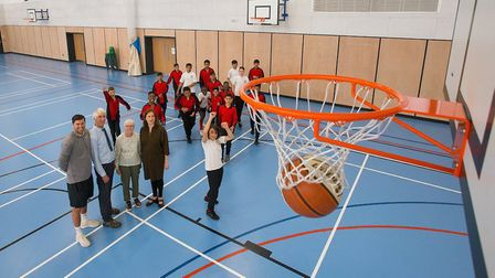 Year 8 pupils from Barking Abbey with, from left to right, Scott Leather, PE teacher, Dennis Wright,