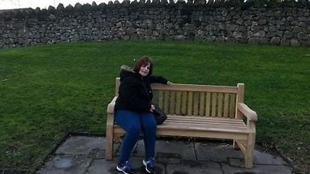 Michelle Grant on the bench dedicated to her father, John Bloom. Picture: Michelle Grant.