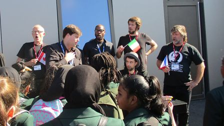 Performers from the English National Opera singing to pupils at Greatfields School in Barking. Pictu