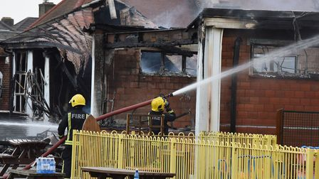 Firefighters tackling the blaze which severely damaged part of Roding Primary School in Dagenham. Pi