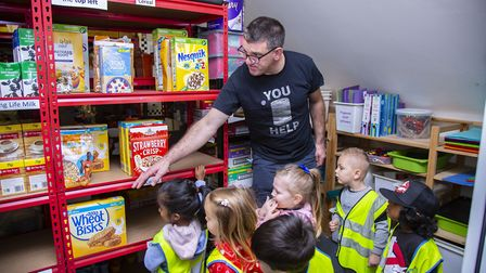 Barney Bears Nursery pupils are shown around the food bank at Bethel Christian Centre. Picture: Elli