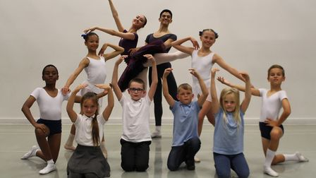 Students from the Royal Ballet School working with pupils at Dagenham Park primary school. Picture: