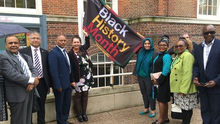 About 30 people braved the rain to see the Black History Month flag raised at Barking Town Hall on T