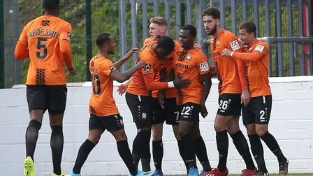 Josh Walker of Barnet (22) scores the first goal for his team and celebrates with his team mates dur