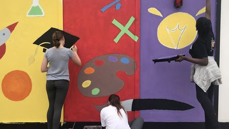 Robert Clack School pupils paint a mural on the hoarding at the Lymington Fields site. Picture: Bark