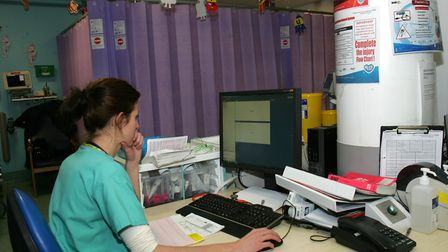 Staff member working in the emergency department at Queen's Hospital. Picture: Paul Bennett.