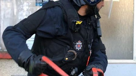 Essex Police carrying out a raid on one of the properties. Picture: Essex Police