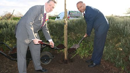 Cllrs Darren Rodwell and Syed Ghani dig deep for the environment. Picture: LBBD