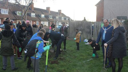 Pupils and staff came together with residents of the area to dig a path, dig out flower beds and pla