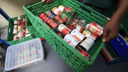 Food being sorted at a foodbank. Picture: Jonathan Brady/PA.