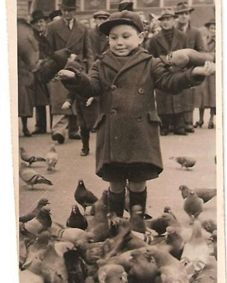 Ron Lloyd aged seven at Trafalgar Square on May 8, 1945, at the VE Day Celebrations. The bus in the