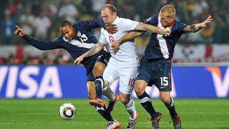 England's Wayne Rooney (centre) battles for the ball with USA's Ricardo Clark (left) and Jay DeMerit