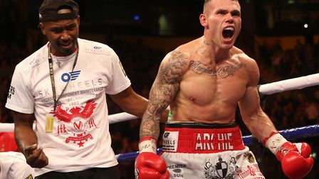 Martin Murray celebrates with trainer Oliver Harrison (left) after defeating Jorge Navarro in their