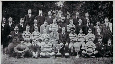 Barking face the camera in 1921-22, with Jack Leslie seen sitting with the ball at his feet next to