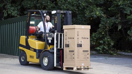 One of the ventilators being brought to the final truck to be sent out. Picture: Steve Parsons/PA Wi