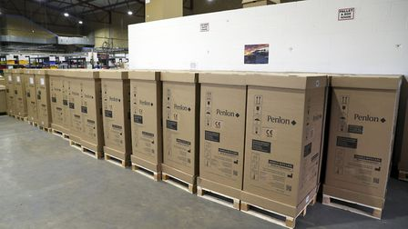 Some of the final ventilators produced by the consortium waiting to be despatched. Picture: Steve Pa