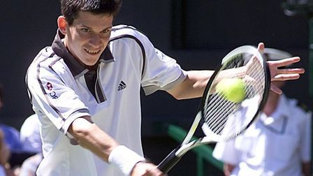 Tim Henman in action at Wimbledon