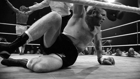 Richard Dunn is floored by Joe Bugner at the Empire Pool, Wembley