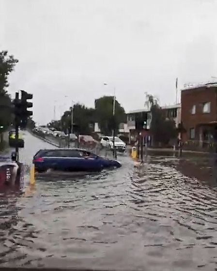 A driver makes their way through a flooded road in Dagenham. The Met Office has warned there is a fu