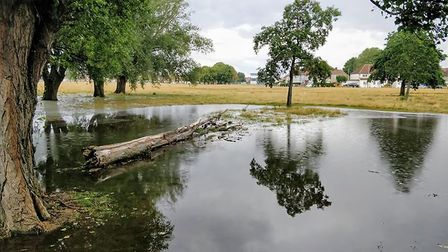 Flooding created a temporary lake in Parsloes Park today (August 17). Picture: Alex Clark