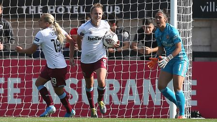 Martha Thomas of West Ham scores the first goal for her team and celebrates during Arsenal Women vs