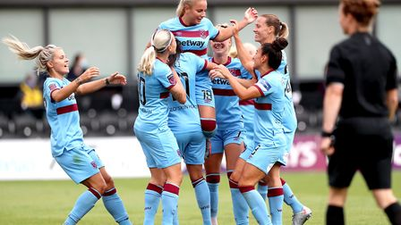 West Ham United's Adriana Leon (centre) celebrates scoring her sides first goal with her teammates d