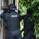 Police carrying out a drugs raid in Suffolk. Picture: KAREN WILLIE