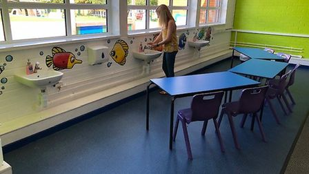 Year 1 teacher Bronwyn Coleman washes her hands in newly-installed extra sinks at St Williams Primar