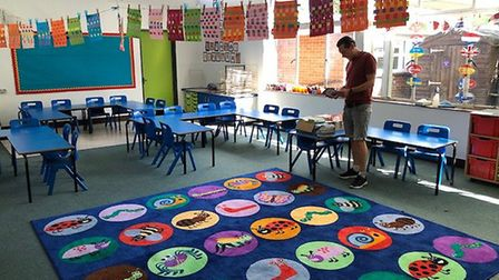 Year 6 teacher Dave Moreton preparing his classroom at St Williams Primary School in Thorpe St Andre