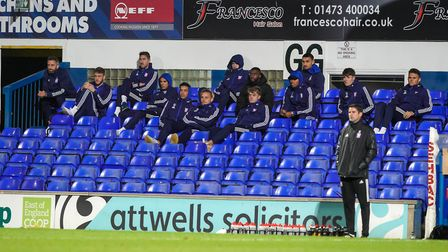 Town players not in the playing squad look on.Picture: Steve Wallerwww.stephenwaller.co