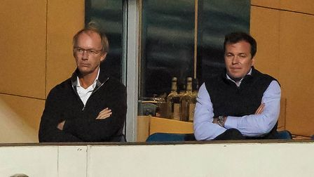 Ipswich Town owner Marcus Evans and general manager of football operations Lee O'Neill watch on.