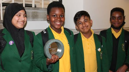 Lower school pupils at Sydney Russell with the Champion Heritage School Award from Historic England.