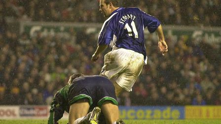 Cool as a cucumber. Marcus Stewart nets Town's winner at Anfield, in December 2000