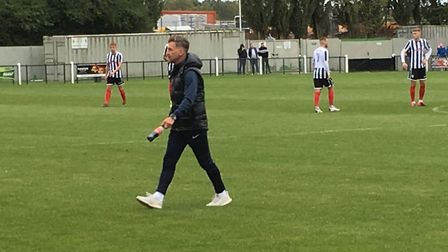 Leiston manager Darren Eadie walks off the pitch after giving some late instructions to his players