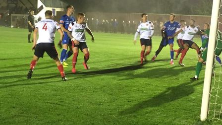 Bury Town launch another attack from within Witham's penalty area during the Isthmian League North c