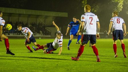 Ollie Hughes slams home Bury Town's third goal, against Witham Town. Picture: NEIL DADY