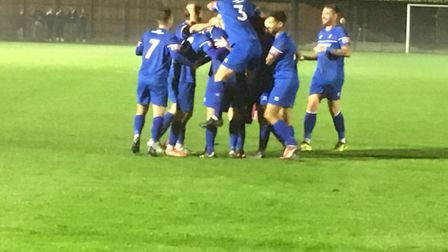 Bury Town players celebrate after Ollie Hughes had blasted home the third goal. Bury were leading WI