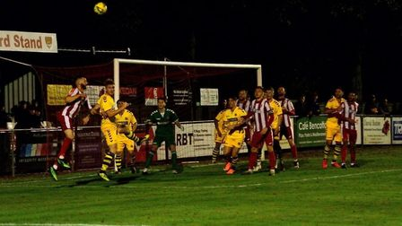 Action from last night's Suffolk derby in the Isthmian League, where Felixstowe & Walton United (red