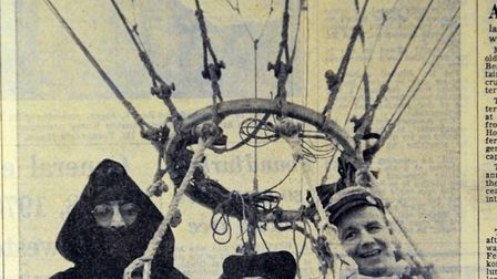 John Lennon and Yoko Ono pictured in the basket of their hot air balloon int Lavenham from the page