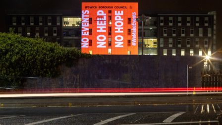 Campaigners lit up Grafton House in Ipswich Picture: GREEN SPARK