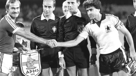 Ipswich Town skipper Mick Mills shakes hands with the Aris Salonika captain. Town won the first leg